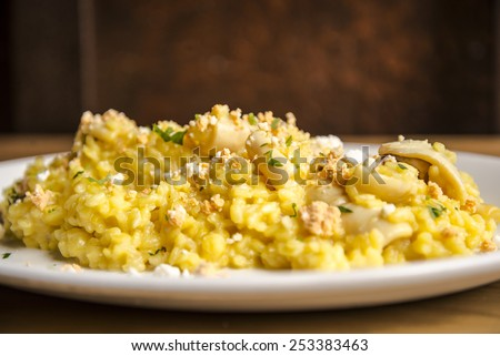 Rice with cheese and seafood - stock photo