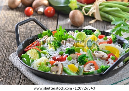 Rice with mixed vegetables in a serving pan - stock photo