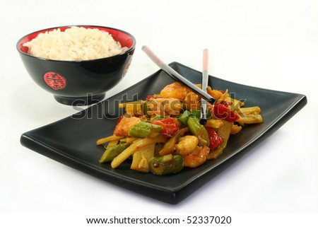Rice with shrimp and Asian vegetable stir-fry on Asian dishes - stock photo