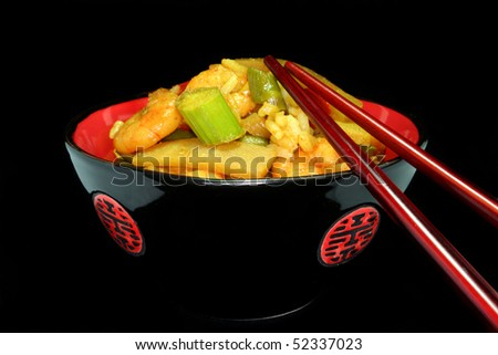 Rice with shrimp and vegetable stir-fry Asian in an Asian dish - stock photo