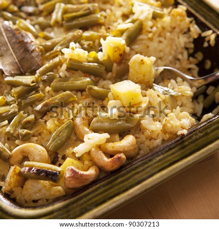 Rice with vegetables and nuts (indian food) - stock photo