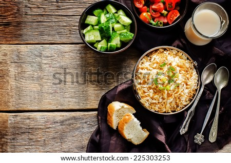 Rice with vermicelli on a dark background. Traditional Arabic dish. tinting. selective focus on green onions - stock photo