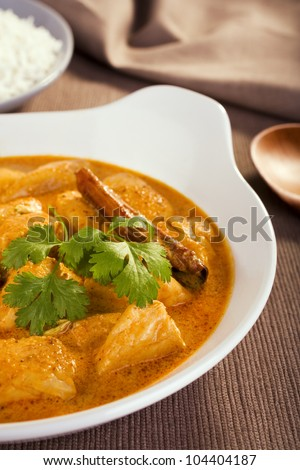 Rich and luxurious, butter chicken is mild and creamy and is enriched with cream and yoghurt. Here served with basmati rice. Not for the diet conscious, but a special treat is good for you too. - stock photo