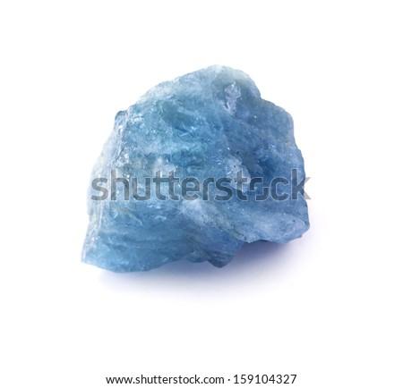 Rich blue color aquamarine gem stone isolated on the white background. - stock photo