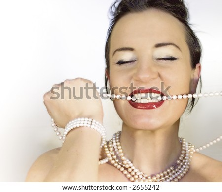 rich girl with perls an red lips - stock photo