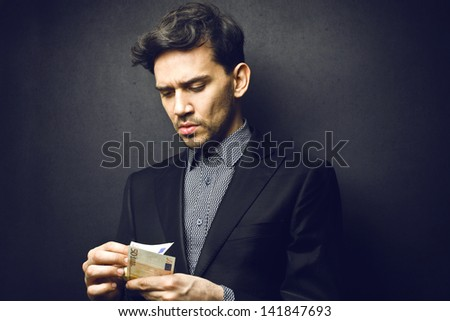 rich man counts the money - stock photo