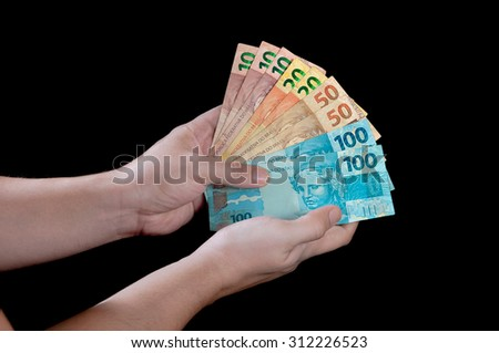 rich man holding a lot of money - stock photo