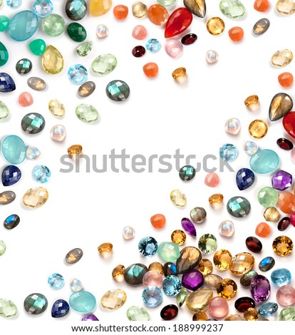 Rich semiprecious gems collection on the white background. Many real stones: amethyst, jade, moonstone rainbow, labradorite, lapis lazuli, aquamarine, blue topaz, rose quartz, citrine, prehnite ... - stock photo