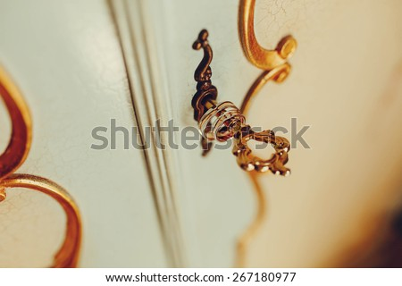 rich shiny gold rings for brides old style door cracked paint background baroque - stock photo