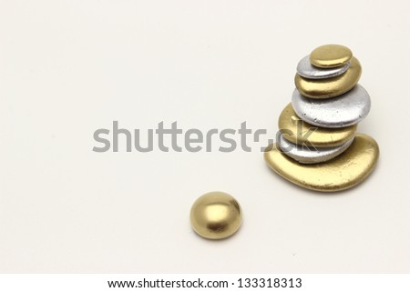 Richness of gold pebbles or nuggets - stock photo