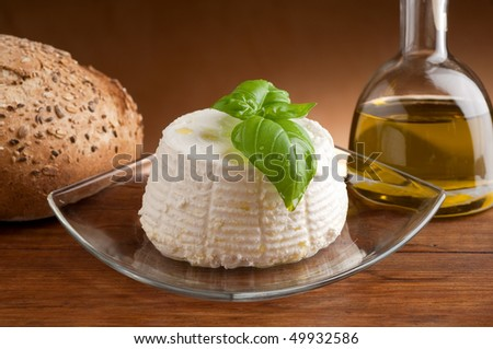 ricotta with bread and bottle of olive oil - stock photo