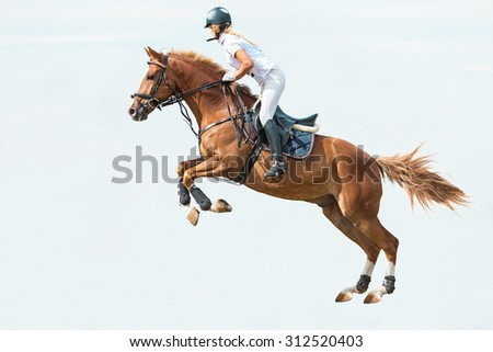 Rider jumping on horse on blue sky background - stock photo