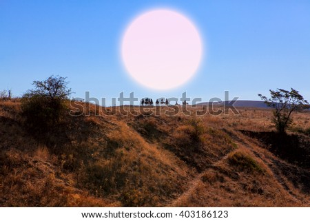 riders at moon rising - stock photo