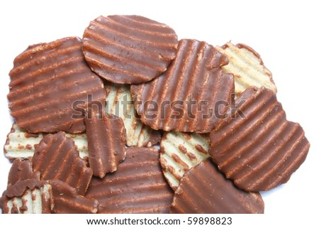 Ridged potato chips cover with Chocolate isolated on white - stock photo