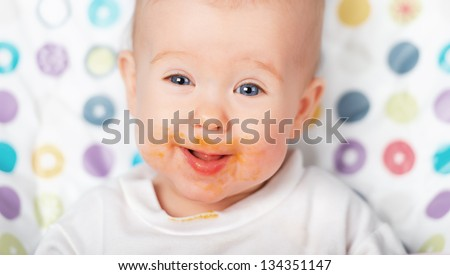 ridiculous funny baby eating dirty grimy - stock photo