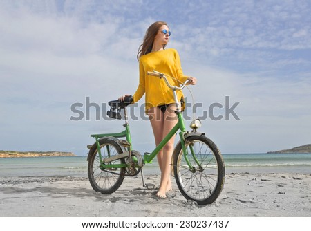 Riding a bike at the seaside  - stock photo