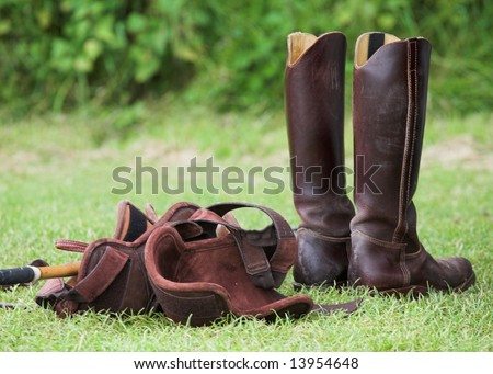 Riding Boots and Knee Protectors - stock photo