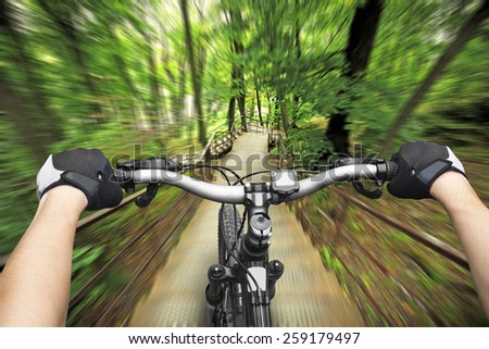 Riding on big speed on bicycle on stairs in park - stock photo