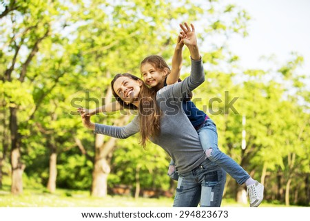 Riendly, cheerful family having a picnic. - stock photo