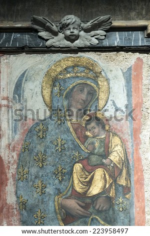 RIETI, ITALY - JULY 14, 2014: interior of the medieval duomo, in baroque style. Church built in 12th and 13th century, catholic place of worship. Detail of painting - stock photo