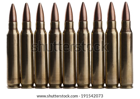 Rifle bullets in a row isolated on white background - stock photo