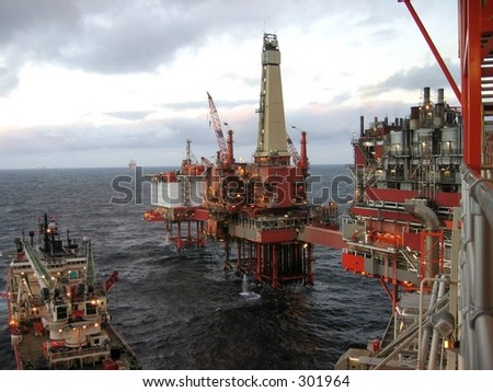 Rig and production facility on north sea oil field. - stock photo