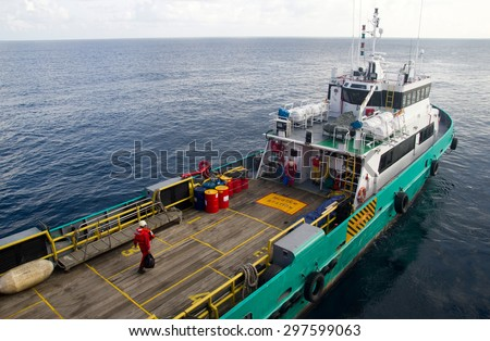 Rig workers are transported on a vessel to offshore rigs  - stock photo