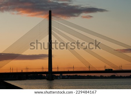 Riga, cable-stayed bridge at sunset - stock photo