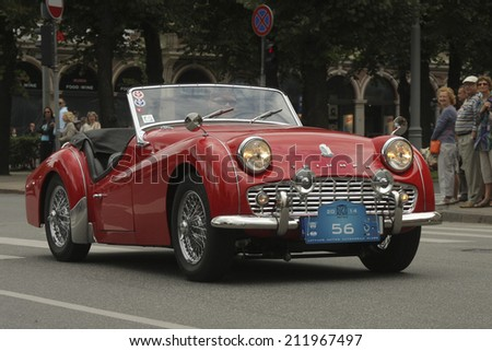 RIGA, LATVIA - AUGUST 16: Parade of old cars on the Riga City Festival in Riga on August 16, 2014 in Latvia. - stock photo