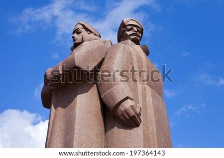RIGA, LATVIA - JUNE 3RD 2014: The impressive Latvian Riflemen monument in Riga on 3rd June 2014. - stock photo