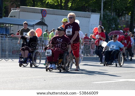 RIGA, LATVIA - MAY 23:  Disabled people participate in the Riga International Marathon in May 23, 2010, Riga, Latvia. - stock photo