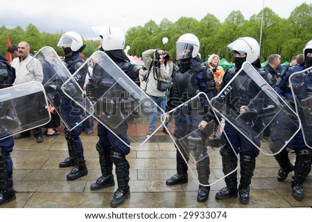 RIGA, LATVIA, MAY 9, 2009: Riot police ready to exclude provocation at celebration of May 9 Victory Day (Eastern Europe) in Riga at Victory Memorial to Soviet Army - stock photo