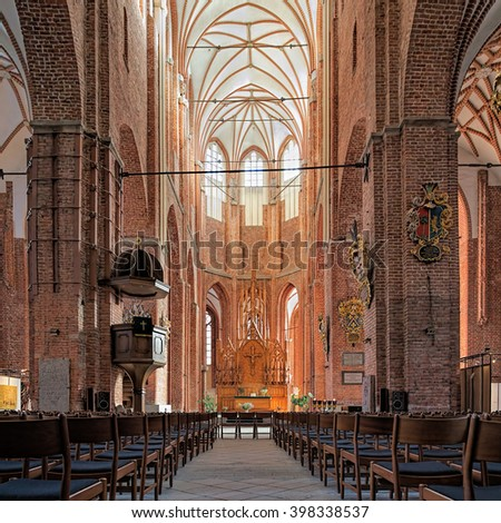 RIGA, LATVIA - OCTOBER 12, 2011: Interior of the St Peter's Church, the city's oldest religious building. The church is first mentioned in 1209. Current interior is the result of renovation after WWII - stock photo