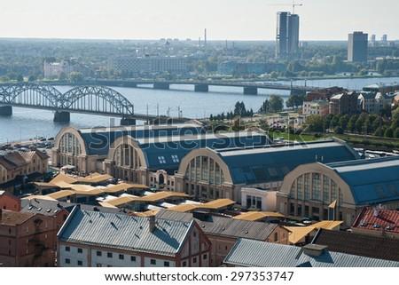 RIGA, LATVIA - SEPTEMBER 03, 2014 - View of pavilions central market , warehouses and bridges. - stock photo