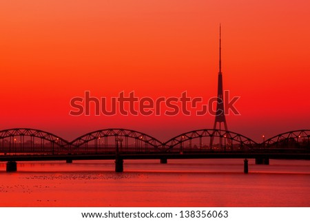Riga Radio and TV Tower with famous railway bridge at sunset - stock photo