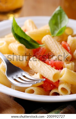 rigatoni pasta with chopped tomatoes and basil - stock photo