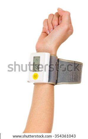 Right arm vertically wearing glucose meter around wrist with white background. - stock photo