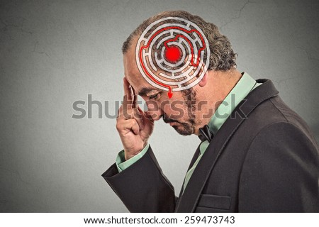 Right decision wisdom strategy concept. Side profile middle aged man solving problem isolated on gray wall background. Face expression  - stock photo