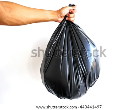 Right hand hold big garbage bag isolated on white background - stock photo
