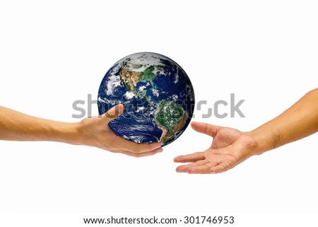 right hand holding globe and give to other hand. Elements of this image furnished by NASA - stock photo