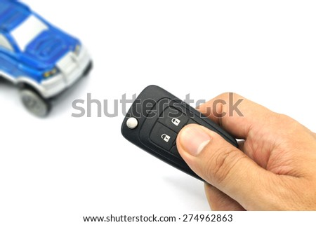 Right hand holding remote control car key for business concept - stock photo