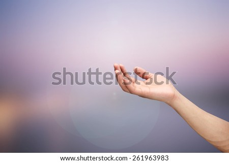 Right hand open palm gesture ob blurred night background - stock photo
