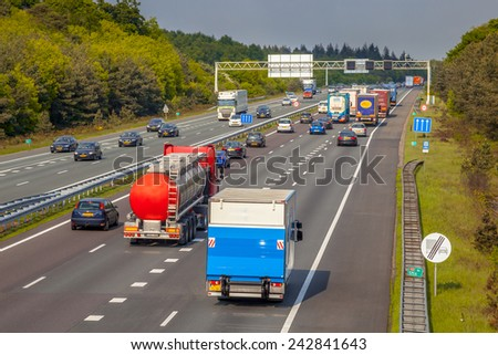 Right hand side Evening freeway Traffic on the A12 Motorway. One of the Bussiest highways in the Netherlands - stock photo