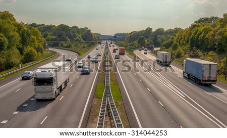 Right hand side Evening Traffic on the A12 Motorway through the Veluwe forest. One of the Busiest highways in the Netherlands - stock photo
