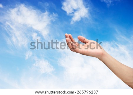 Right hand with empty on blue sky  backgrounds with selective focus,soft focused - stock photo