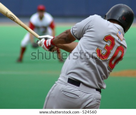 Right-handed baseball batter, close-up right-handed, swinging hard - stock photo