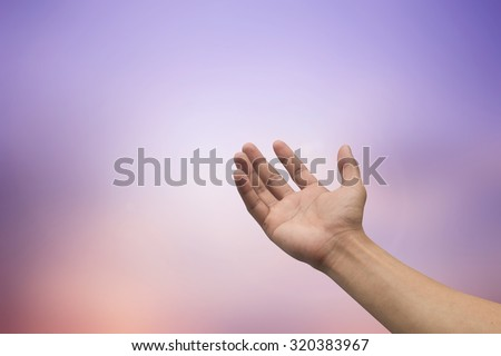 right hands praying on blurred twilight sunset sky background : humans hand open gesture reaching and receiving power from god. religion concept :eucharist concept:forgiveness concept. - stock photo