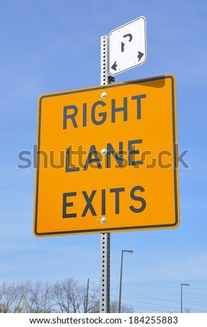 Right lane exits sign - stock photo