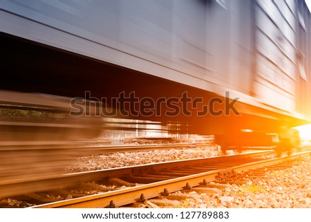 righto train passing by on sunset beam - stock photo