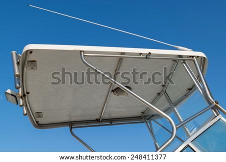 Rigid boat canopy in fiberglass and aluminum with antenna - stock photo